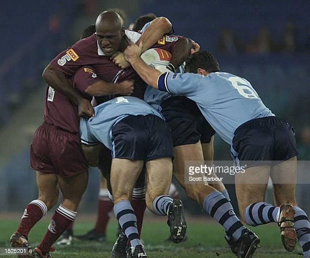 Wendell Sailor of Queensland is tackled by Brad Fittler and Brett Kimmorley of New South Wales during game three of the State of Origin Rugby League...