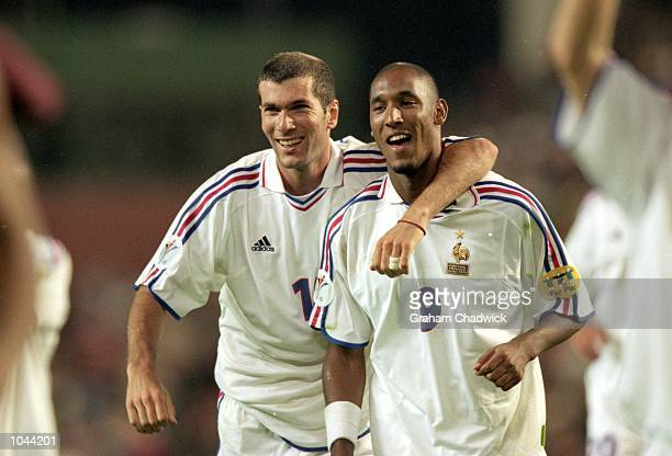 Zinedine Zidane and Nicolas Anelka of France celebrate after the European Championships 2000 semifinal against Portugal at the King Baudouin Stadium...