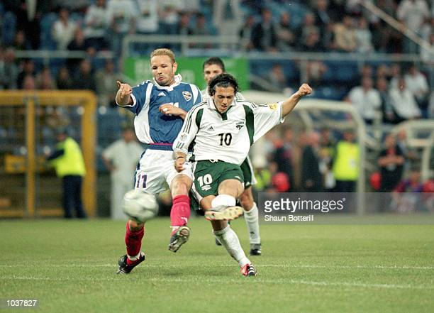 Zlatko Zahovic scores the third for Slovenia during the European Championships 2000 group match against Yugoslavia at the Stade Communal in...