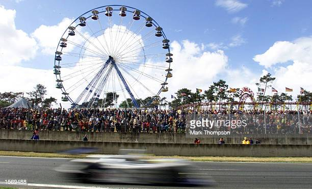 A sports car passes the funfair at the start of the Le Mans 24 Hour Race La Sarthe France Mandatory Credit Mark Thompson/ALLSPORT