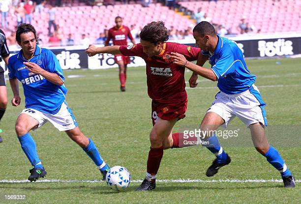 Abdelilah Saber of Napoli and Vincenzo Montella of Roma in action during the Serie A 33rd Round League match between Napoli and Roma played at the...
