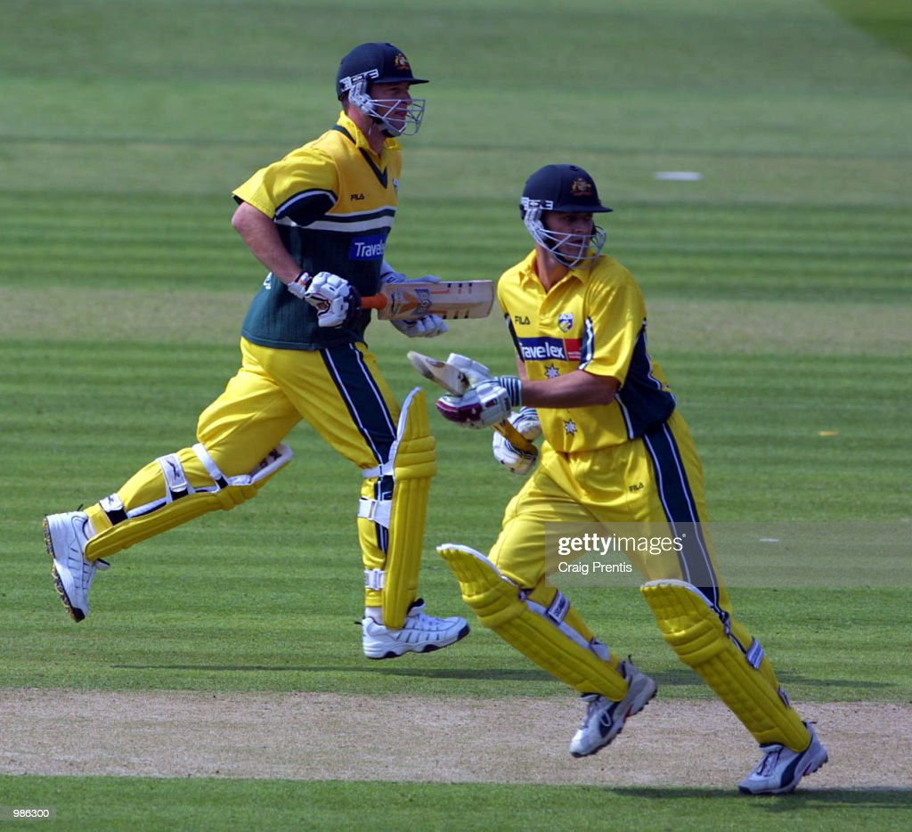Adam Gilchrist [right] and Mark Waugh of Australia cross during the Natwest Trophy Final between Australia and Pakistan at Lord's, London. +DIGITAL IMAGE+ Mandatory Credit: Craig Prentis/ALLSPORT