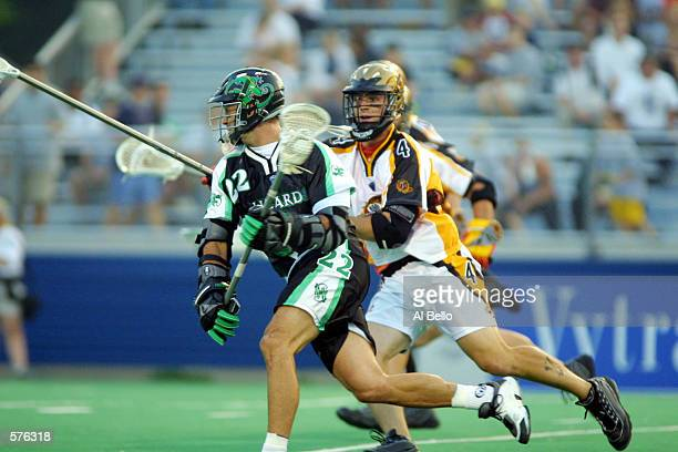 AJ Haugen of the Long Island Lizards runs with the ball against Casey Conner of the Rochester Rattlers during their Major League Lacrosse home opener...
