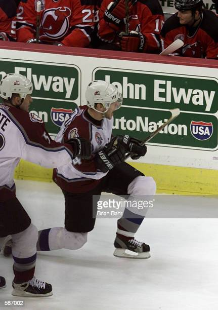 Alex Tanguay of the Colorado Avalanche celebrates his first goal with Adam Foote in Game 7 of the Stanley Cup finals at the Pepsi Center in Denver...