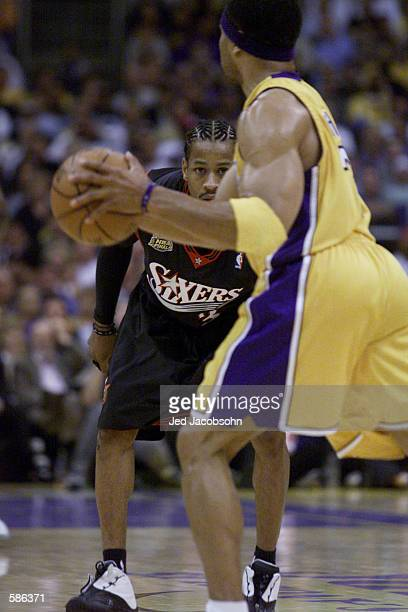 Allen Iverson of the Philadelphia 76ers defends Derek Fisher of the Los Angeles Lakers in game one of the NBA Finals at Staples Center in Los...