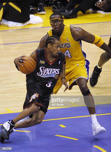 Allen Iverson of the Philadelphia 76ers dribbles around Horace Grant of the Los Angeles Lakers during Game 1 of the NBA Finals at Staples Center in...