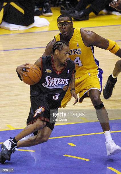 Allen Iverson of the Philadelphia 76ers drives past Horace Grant of the Los Angeles Lakers in game one of the NBA Finals at Staples Center in Los...