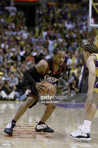 Allen Iverson of the Philadelphia 76ers in action against Tyronn Lue of the Los Angeles Lakers game one of the NBA Finals at Staples Center in Los...