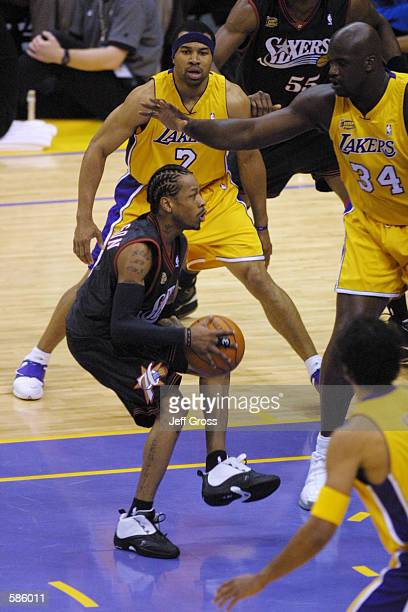 Allen Iverson of the Philadelphia 76ers is surrounded by the Los Angeles Lakers defense in game one of the NBA Finals at Staples Center in Los...