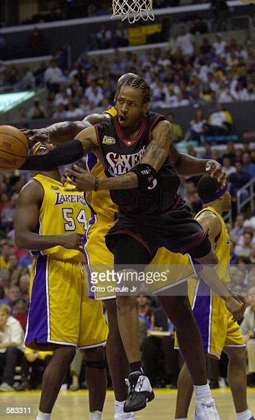 Allen Iverson of the Philadelphia 76ers leaps for the ball around the Los Angeles Lakers defense during Game 1 of the NBA Finals at Staples Center in...