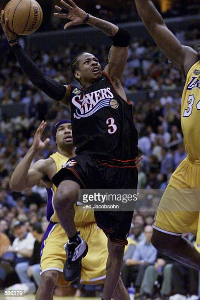 Allen Iverson of the Philadelphia 76ers puts a shot up in game one of the NBA Finals against the Los Angeles Lakers at Staples Center in Los Angeles,...