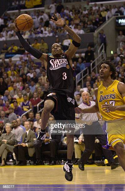 Allen Iverson of the Philadelphia 76ers puts up a shot over Rick Fox of the Los Angeles Lakers during Game 1 of the NBA Finals at Staples Center in...