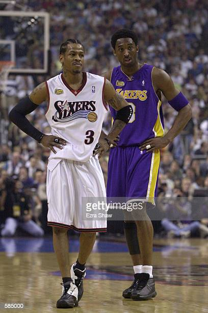 Allen Iverson of the Philadelphia 76ers stands with Kobe Bryant of the Los Angeles Lakers during game 3 of the NBA Finals at the First Union Center...