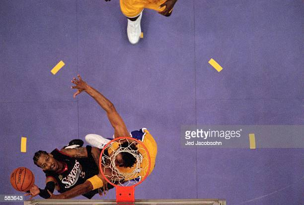 Allen Iverson of the Philadelphia 76ers tries to shoot the ball against Rick Fox of the Los Angeles Lakers during the NBA Finals Game 1 at the...