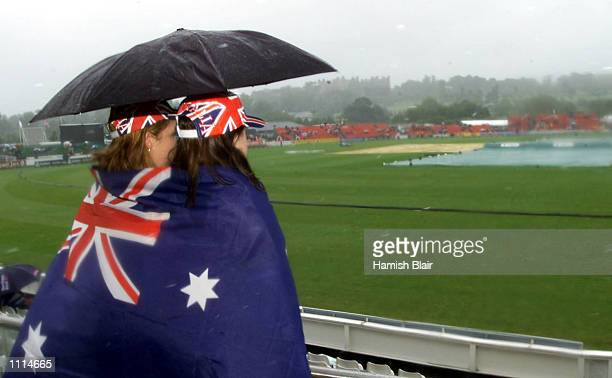 Australian fans Trisha Cattell and Megan Mooney from Brisbane look on as rain delays the start of the One Day International between Australia and...