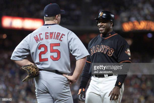 Barry Bonds of the San Francisco Giants talks with Mark McGwire of the St Louis Cardinals at Pac Bell Park in San Francisco California <DIGITAL...