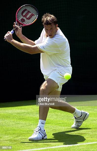 Barry Cowan of Great Britain in action against Mark Hilton of Great Britain during the mens first round of The All England Lawn Tennis Championship...