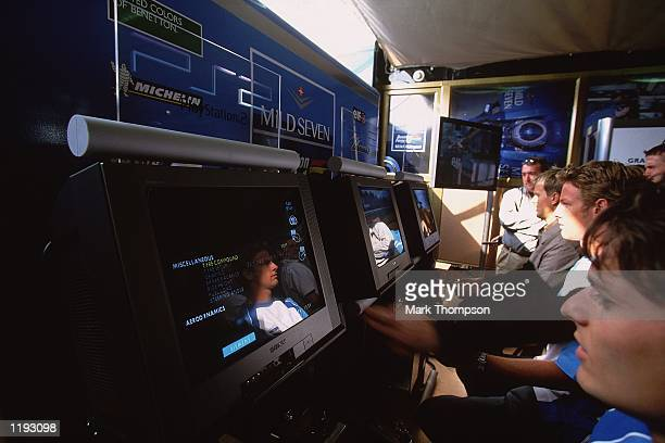 Benetton drivers Giancarlo Fisichella of Italy and Jenson Button of Great Britain play the Playstation 2 Formula One game during the European Formula...