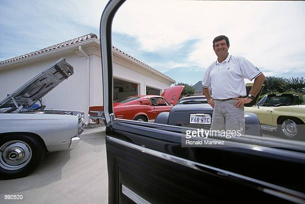 Bruce Lietzke poses with his car collection at his home in Plano TexasMandatory Credit Ronald Martinez /Allsport
