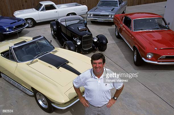 Bruce Lietzke poses with his car collection at his home in Plano Texas His cars are clockwise from lower left a 1967 Corvette C2 427 a blue late...