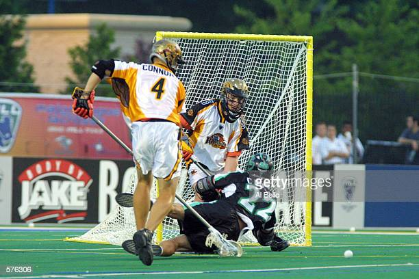 Casey Powell of the Long Island Lizards fights for the ball against Casey Conner and Brian Doughrety of the Rochester Rattlers during their Major...