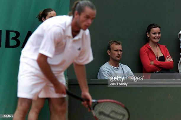 David Felgate former coach of Tim Henman watches his new player Xavier Malisse of Belguim before losing his third round match against Michael Russell...