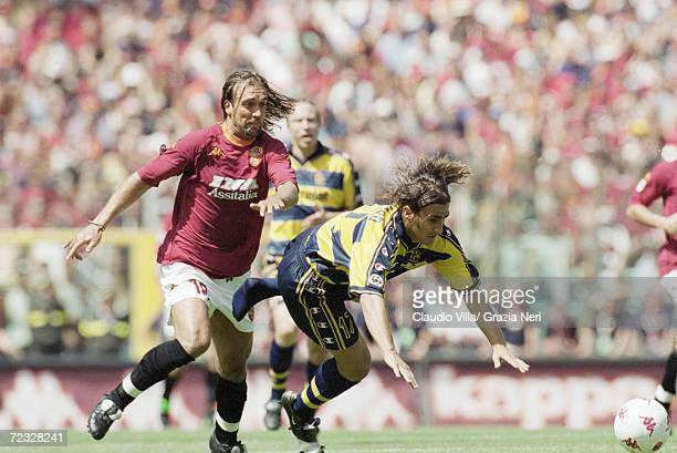 Fabio Cannavaro of Parma is tripped by Gabriel Batistuta of Roma during the Serie A match against Parma at the Stadio Olimpico in Rome Roma won 31 to...