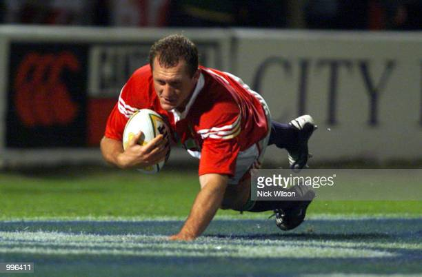 Flanker Richard Hill of the British Lions on his way to scoring a try against the Queensland Reds during the match between the British Lions and the...