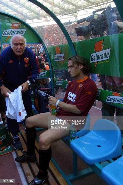 Francesco Totti sits on the bench without his shorts after Roma fans invade the pitch and steal them from him minutes before the end of the Serie A...