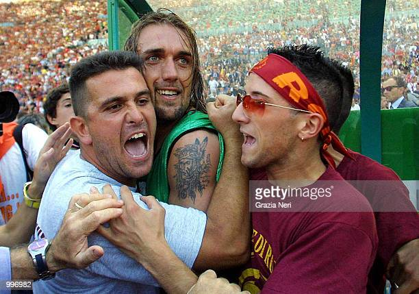 Gabriel Batistuta celebrates winning the scudetto with Roma fans after the eventual completion of the Serie A 34th Round League match between Roma...