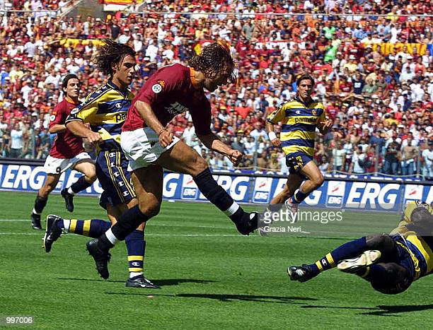 Gabriel Batistuta shoots at goal with Montella waiting in the background to score from the rebound during the Serie A 34th Round League match played...