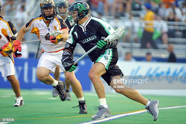 Gary Gait of the Long Island Lizards runs with the ball against Regy Thorpe of the Rochester Rattlers during their Major League Lacrosse home opener...