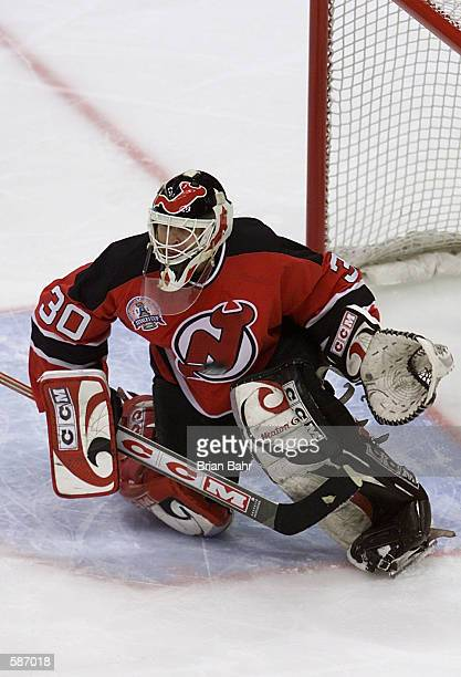 Goalie Martin Brodeur of the New Jersey Devils allows a goal as the puck flies past him during Game 7 of the Stanley Cup finals at the Pepsi Center...