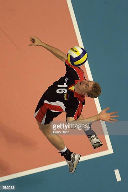 Ilja Weiderschein of the German National Volleyball team serves up the ball against the USA at the World Arena in Colorado Springs Colorado The USA...