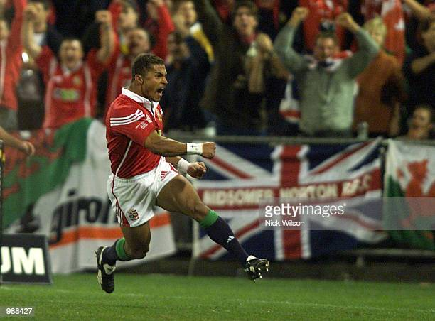 Jason Robinson of the British and Irish Lions scores the first try against Australia during the First Test Match between the British and Irish Lions...