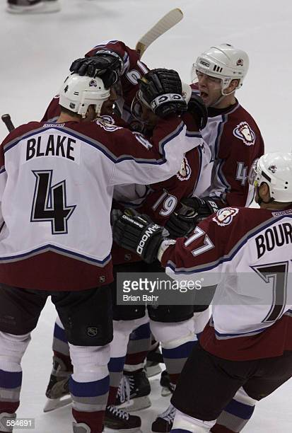 Joe Sakic of Colorado Avalanche is congratulated by Rob Blake Milan Hejduk Alex Tanguay and Ray Bourque after scoring in the second period against...