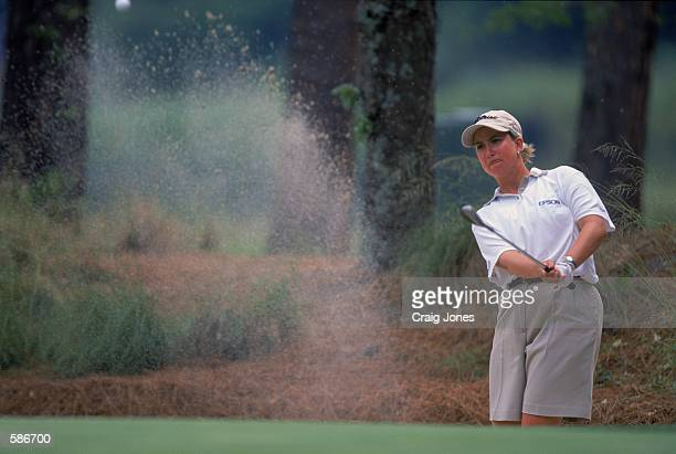 Karrie Webb pops her ball out of a sand trap bunker during the Women's US Open Tournament part of the LPGA Tour at the Pine Needles Lodge and Golf...