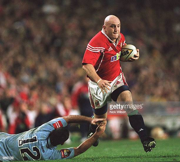 Keith Wood of the Lions charges through the NSW defence during the game between British and Irish Lions and NSW Waratahs played at the Sydney...