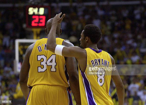 Kobe Bryant and Shaquille O''Neal of the Los Angeles Lakers walk back down court during Game 1 of the NBA Finals against the Philadelphia 76ers at...