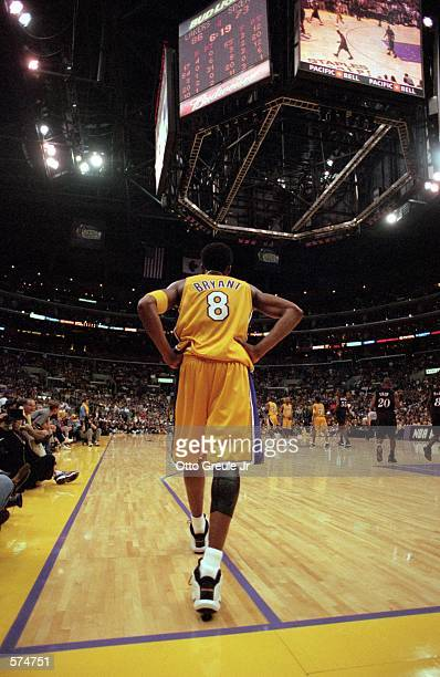 Kobe Bryant of the Los Angeles Lakers walks out to the court during the NBA Finals game against the Philadelphia 76ers at the STAPLES Center in Los...