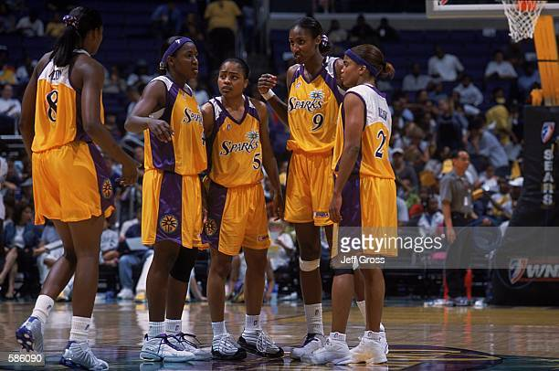 Lisa Leslie of the Los Angeles Sparks discusses a play with teammates Tamecka Dixon Ukari Figgs and Mwadi Mabika during the game against the...