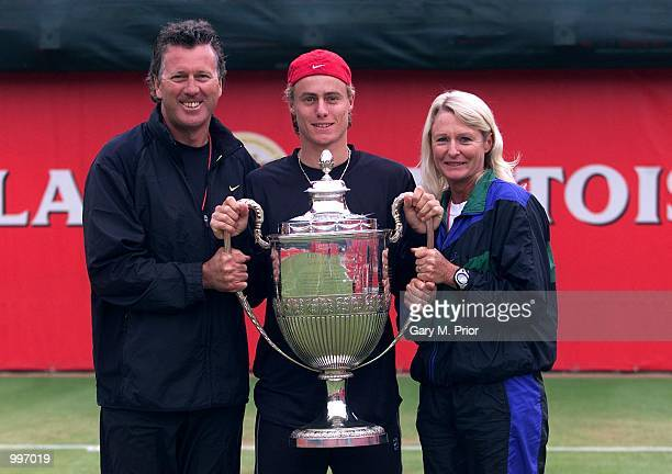 Lleyton Hewitt of Australia after winning the Stella Artois Throphy with his mum and dad after the Final of the Stella Artois Championships at...