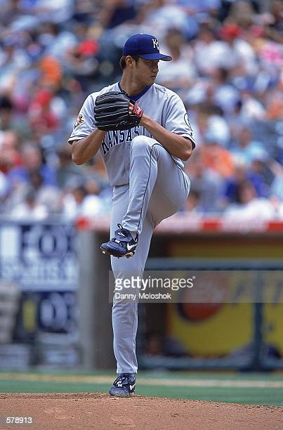Mac Suzuki of the Kansas City Royals starts his wind up during the game against the Anaheim Angels at Edison Field in Anaheim California The Angels...
