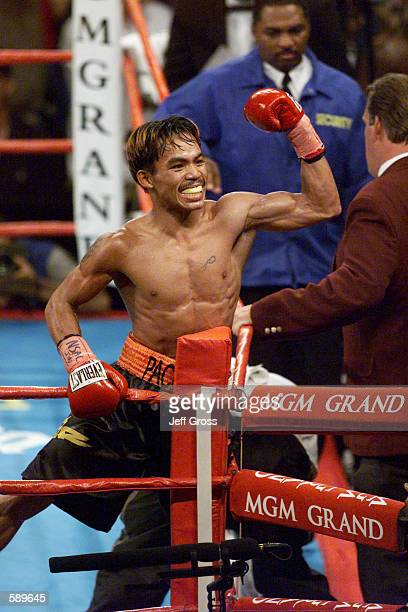 Manny Pacquiao from the Philippines celebrates his victory over Lehlohonlo Ledwaba from South Africa during the IBF Super Bantamweight Championship...