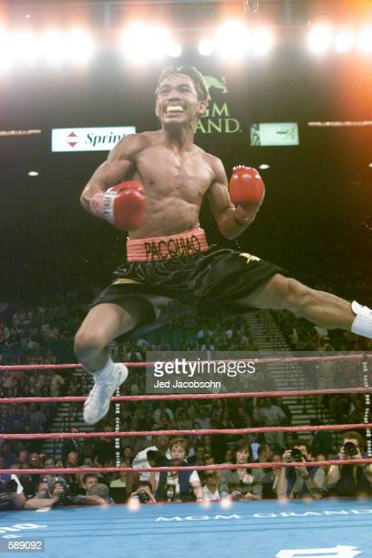 Manny Pacquiao leaps up in jubilation of his victory against Lehlohonolo Ledwaba during IBF Super Bantamweight Championship bout at the MGM Grand...