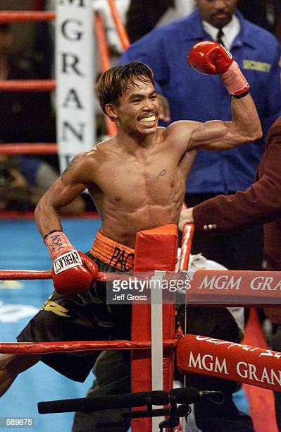Manny Pacquiao of the Philippines celebrates after defeating Lehlohonolo Ledwaba of South Africa during their IBF super bantamweight championship...