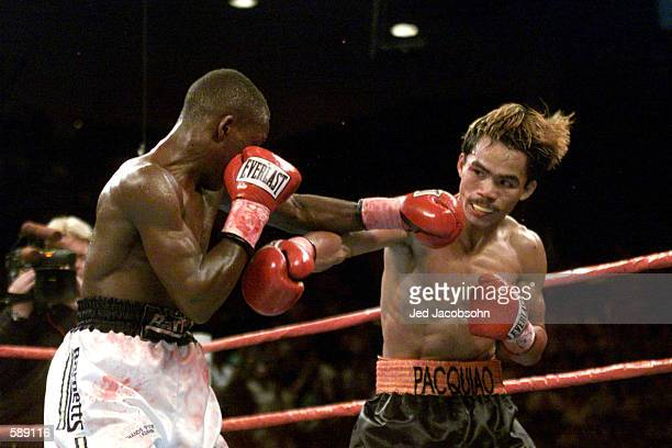 Manny Paquiao and Lehlohonolo Ledwaba fire jabs at eachother during IBF Super Bantamweight Championship bout at the MGM Grand Hotel & Casino in Las...