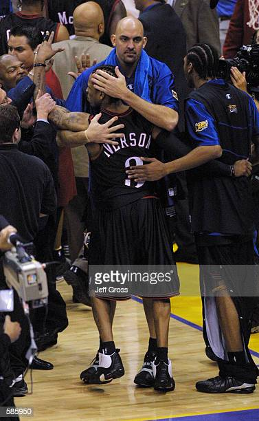 Matt Geiger and Allen Iverson of the Philadelphia 76ers celebrate in game one of the NBA Finals against the Los Angeles Lakers at Staples Center in...