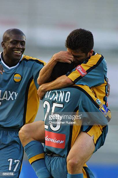 Mauricio Cienfuegos and Ezra Hendrickson of the Los Angeles Galaxy congratulates Marvin Quijano after his goal against the Kansas City Wizards during...