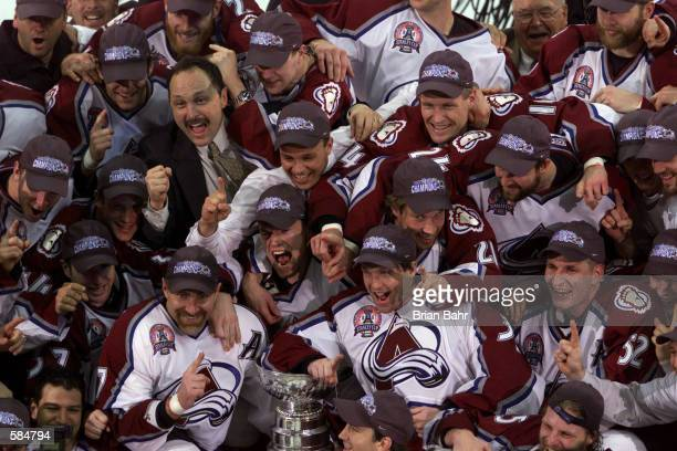 Members of the Colorado Avalanche celebrate defeating the New Jersey Devils to win the Stanley Cup finals at the Pepsi Center in Denver, Colorado....